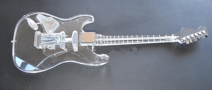 transparent electric guitar with organic glass body and neck