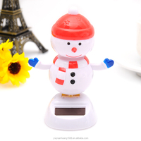 one pound shop snowman doll solar toys solar power shaking toys dancing snowman, car decorative gift sun doll factory wholesale