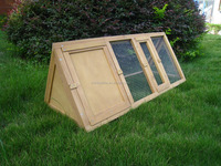 large wooden steel dog house