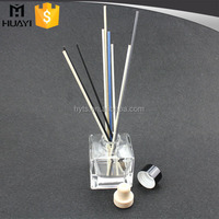 decorative glass bottle reed diffuser with black PP material cap