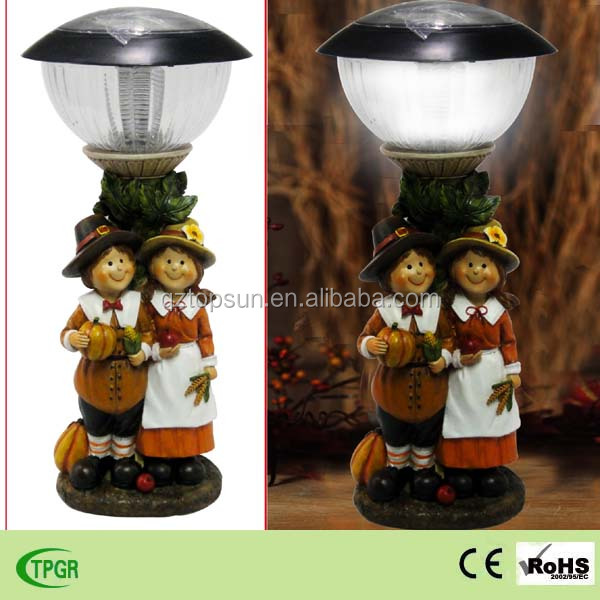 Polyresin children couple figure solar lighting for autumn harvest festival decoration