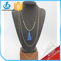 Multi-strand chain jewelry with small plastic bead gold plated cord tassel charm necklace
