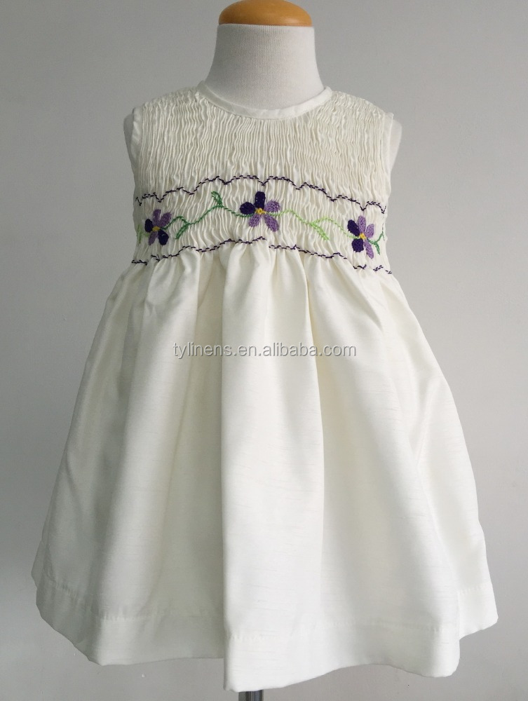 Ivory color shantung children wholesale smocked dresses with flower embroidery