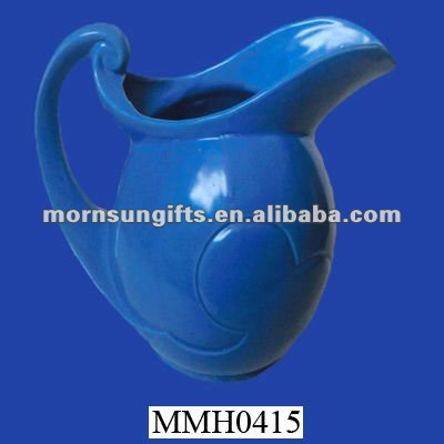 decorative blue pottery water jug