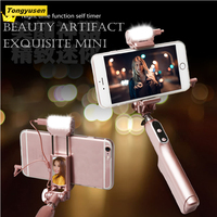 Wholesale bulit-in remote shutter bluetooth/wired control selfie stick with selfie light mirror