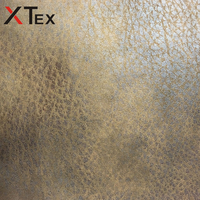 newest design wrap knitted polyester fabric flaky colorized bronzed leather look fabric online upholstery fabrics