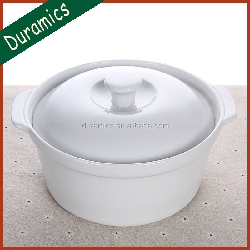 White ceramic round cookware casserole with lid