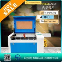 Amazing!Ready goods co2 cnc wood/fabric/wool felt/paper/acrylic/leather laser cutting machine for sale