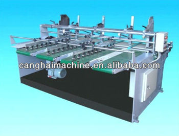 Automatic paperboard sheet feeder