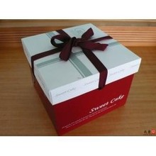 Birthday gift box package with ribbon bow