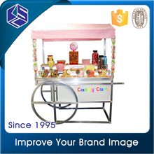 Store promotion new item MDF wood candy display wheel stand store furniture