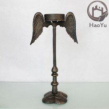 cast iron Angel Wings shaped candle holders