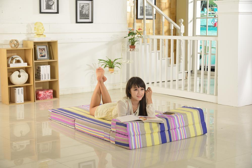 New modern folding sofa bed used as mattress in living room