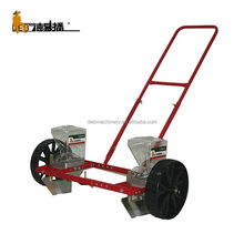 Farmer family use portable double rows manual vegetable hand push seeder for corn, potato, onion