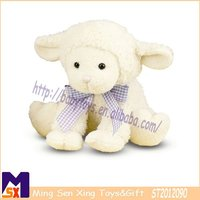 adorable white soft sitting lamb with cute bowtie baby cuddly stuffed toy