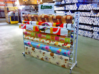Store 2 sides white coil choth stand /carpet rolling display rack