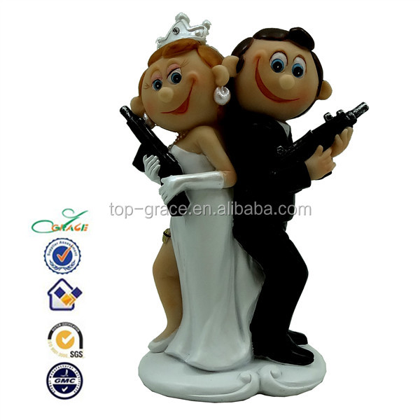 With gun couple wedding decoration cake topper