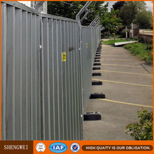 Perforated corrugated metal fence panels for construction site use