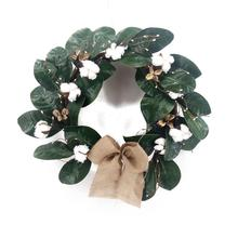 Magnolia leaves and cotton wreath for front door decoration