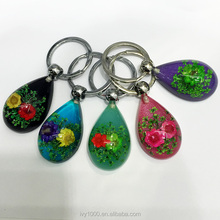 Yiwu Ivy promotional gifts handicrafts resin acrylic flower keychain handmade charming keyrings in hot sale