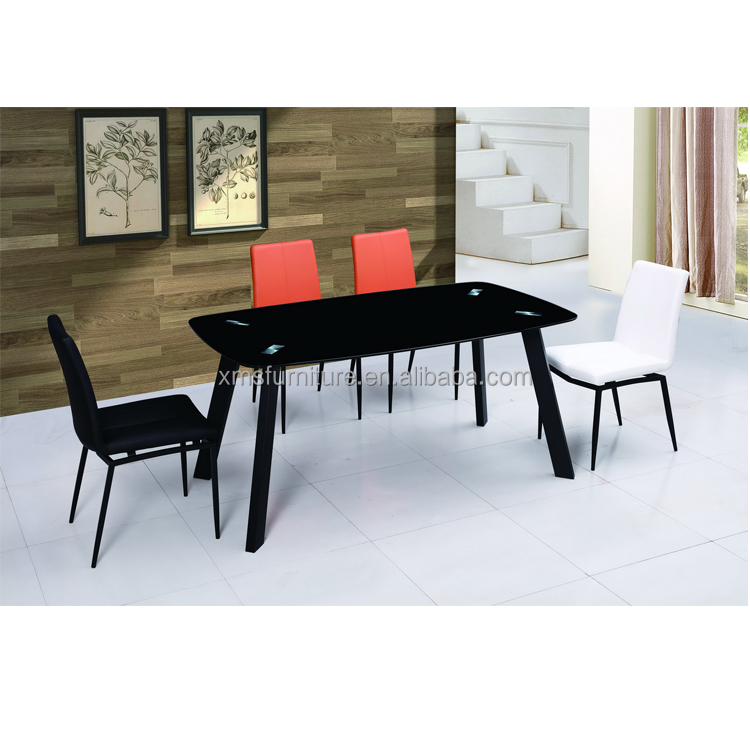 black glass top design dining table with black painting legs