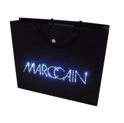 Led lights shinning advertising paper bag