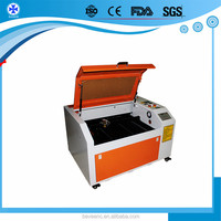 6040 9060 1390 150w 120w High Speed Co2 laser reci tube fabric laser cutting machine with auto cad software