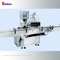 Automatic vacuum filling and packing machine for perfume
