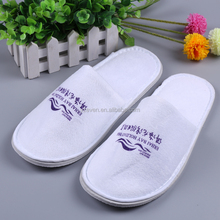 close top white terry slipper for hotel guest disposable use
