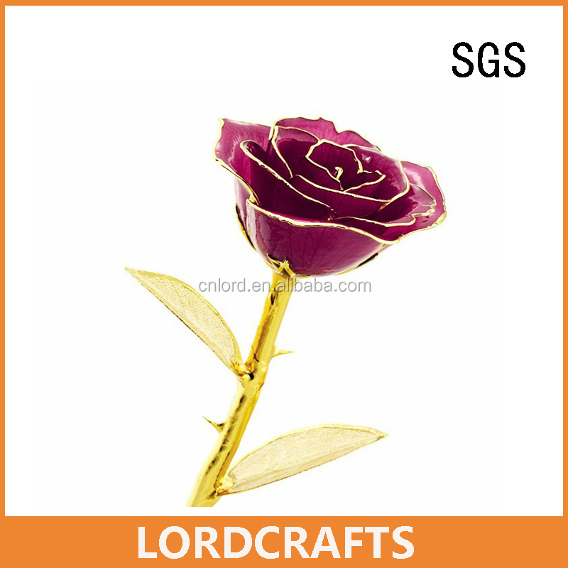 real fresh rose flower dipped in gold with 24k golden leaf