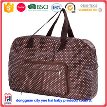 portabe light weight chocolate brown polka dot folding duffle bag