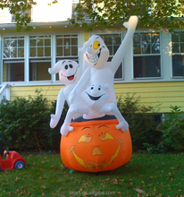 Halloween outdoor decorated with giant inflatable pumpkin and ghost