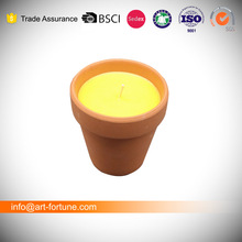 Garden citronella candles in clay ceramic pot for outdoor use