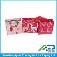 Colorful small size custom paper shopping bag for baby clothes , baby clothes packaging shopping bag with handle