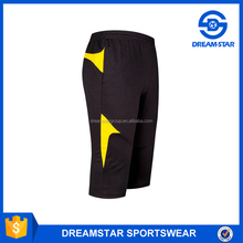 Black and yellow soccer jersey long shorts