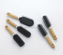 Round wooden handle hair brush with nylon and boar bristles