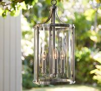 11.29-22 modern and traditional candlestick style lights set within a column of clear glass pendant lamp