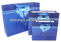 China wholesale ornate paper shopping bags with blue ribbon handle