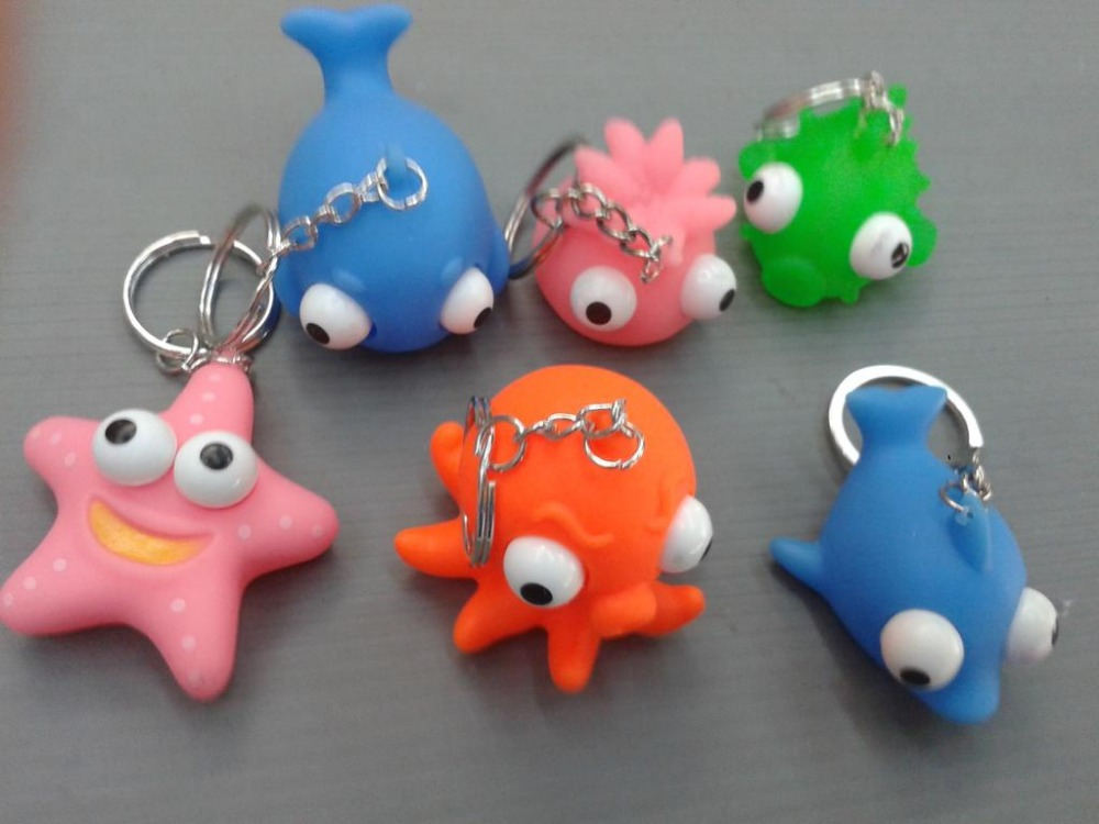 Custom logo soft PVC eyes pop out squeeze toys keychain