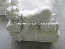 white stone sleeping child statue