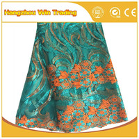 Latest african tulle lace sequin embroidery bridal lace fabric wholesale for Nigeria aso ebi