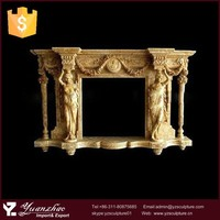 Indoor antique statuary style yellow marble fireplace