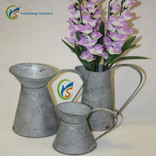 Galvanized metal wedding decorations flowers pitchers
