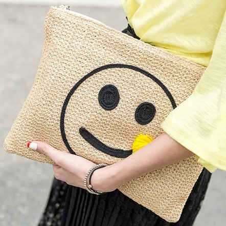 new model straw plaited article smiley face clutch bag