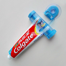 Submarine shaped toothpaste tube squeezer with suction cup