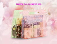 Alibaba china supplier common transparent pvc hand cosmetic bag ,hand bags ,plastic shopping bag with hanger