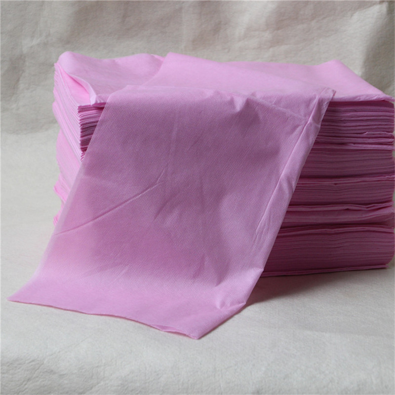 Pink color Disposable Nonwoven Fabric Bed Sheet forTravelling Hotel Beauty Parlor waterproof oil proof bed sheet