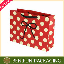 Smart woman luxury red and white shopping paper gift bag with polka dot