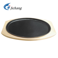 cast iron sizzler with wooden base sizzling <strong>plate</strong>
