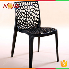 Home furniture modern new design stackable colorful full plastic hollow carved flowers living room chairs